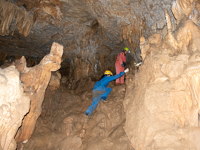 The entrance is a narrow hole. Turn around and slowly enter the cave.
